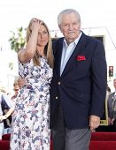 LOS ANGELES - FEB 22:  JENNIFER ANISTON & her dad, JOHN ANISTON arriving to Walk of Fame Ceremony fo