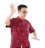 pic of qigong  - Southeast Asian Chinese male practicing tai chi - JPG