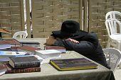 picture of tora  - Hasidic jew sleeping at table at the wailing western wall jerusalem israel - JPG