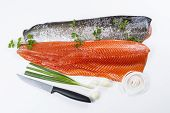 pic of steelhead  - Wild Salmon Fillets with parsley onion garlic and knife on white background - JPG