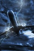 stock photo of striking  - Airplane Lightning Strike Illustration - JPG