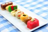 stock photo of halwa  - Assorted colorful sweets of India - JPG