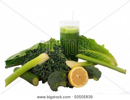 Glass Of Green Vegetable Juice Over White