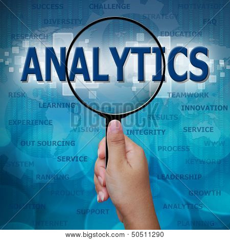 Analytics In Magnifying Glass On Blue Background
