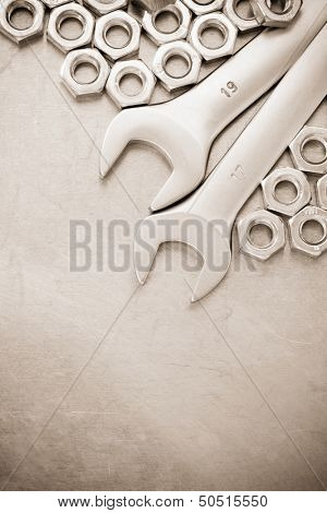 wrench and nut tool on metal  background texture