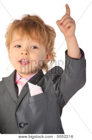 Boy In Suit With Rised Finger