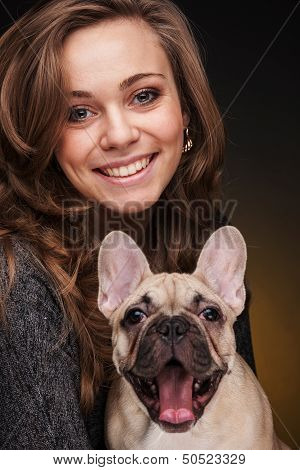 Beautiful girl with french bulldog puppy