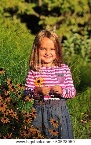 Cute Girl Holding A Flower