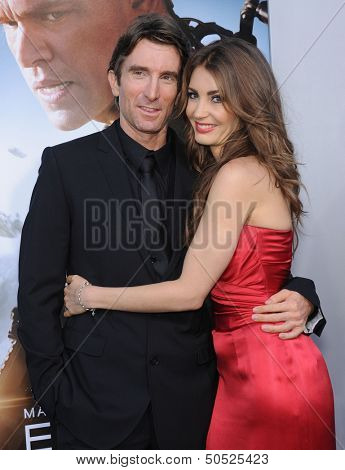 LOS ANGELES - AUG 07:  Sharlto Copley & Tanit Phoenix arrives to