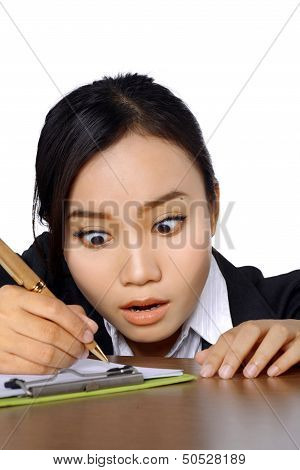 Woman With Funny Expression Writing On The Paperboard