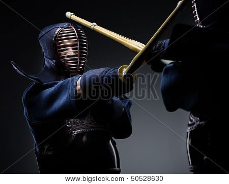 Competition of two kendo fighters. Japanese martial art of sword fighting