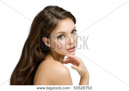 Portrait of naked girl touching her faultless face, isolated on white. Concept of beauty and youth