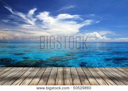 Sea And Wooden Walkway In Summer