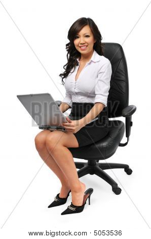 Youns Asian Businesswoman Sitting On Her Chair With Laptop