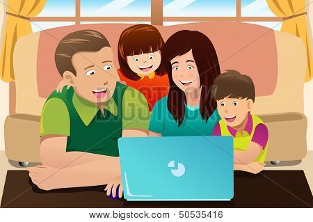Happy Family Looking At A Laptop