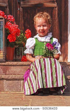 Beautiful little girl in a dirndl
