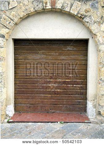 Rusty  Closed Rolling Portcullis  Of Shop