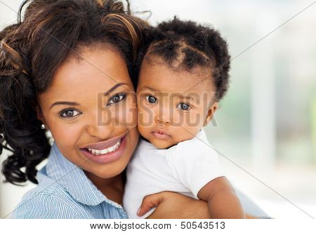 close up portrait of beautiful african mother and baby indoors