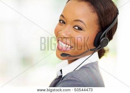 headshot of beautiful female african call center operator