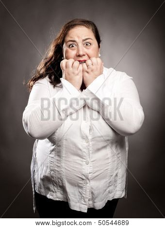portrait of woman scared on gray background