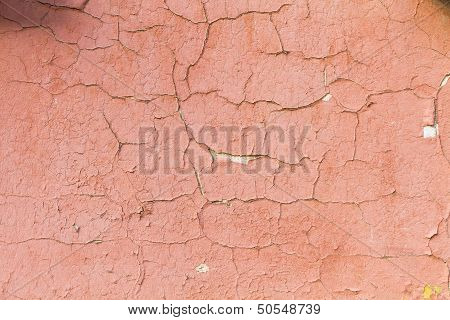 Red Wall On A House With Flaking Paint