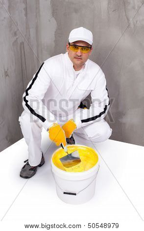 Worker Mixing A Plaster With A Trowel