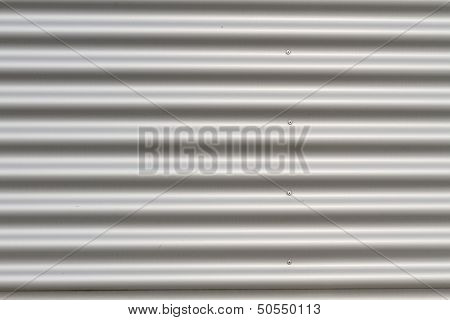 Silver Corrugated Metal On A Building Detail