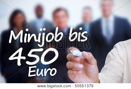 Businessman writing with a marker minijob bis 450 euro in front of a business team
