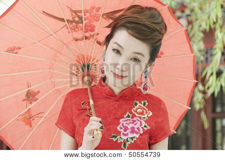 Young Woman in Qipao with Umbrella
