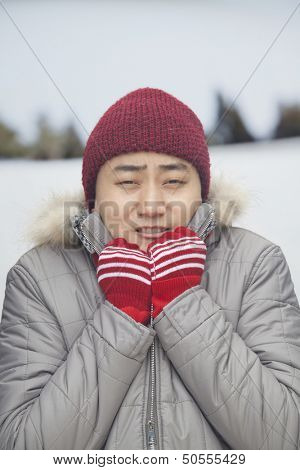 Portrait of young man shivering in cold temperature