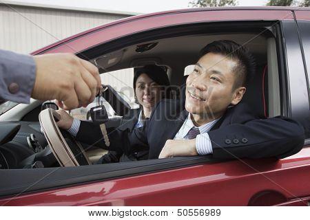 Mechanic Giving Car Keys to Couple