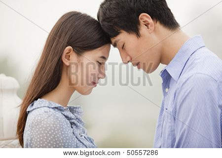 Young Couple Touching Foreheads