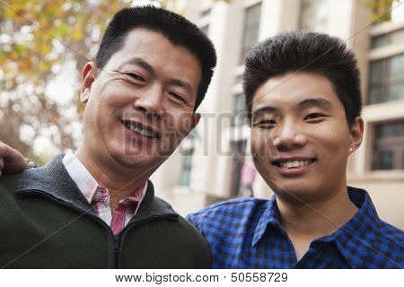 Father and son portrait in front of dormitory