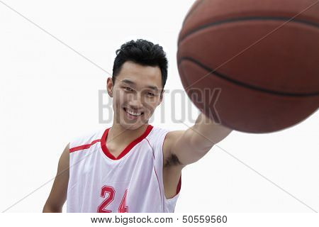 Basketball Player Holding Out Basketball