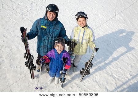 Smiling Family with Ski Gear in Ski Resort