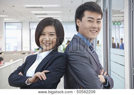 Two Business People with Arms Crossed