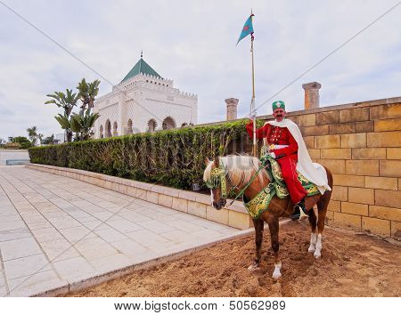 Royal Guard In Front Of The Hassan Tower And Mausoleum Of Mohammed V In Rabat