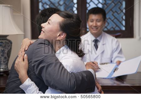 Patient and Spouse Hug at the Good News