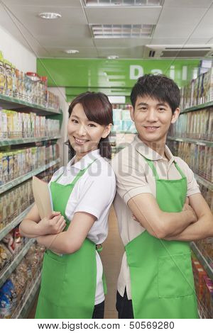 Two Sales Clerks Standing in a Supermarket