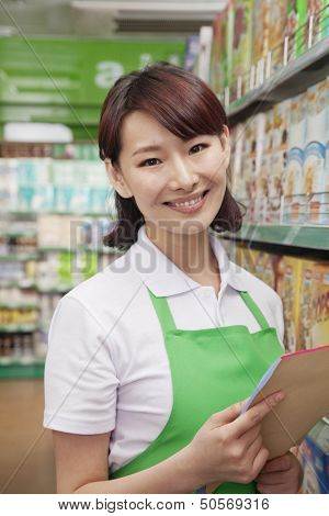 Portrait of Female Sales Clerk in a Supermarket