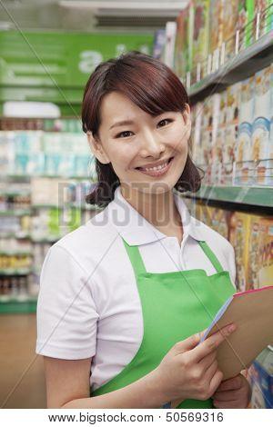 Portrait of Female Sales Clerk in a Supermarket