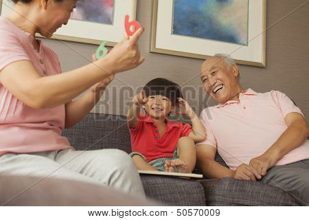 grandson playing with grandparents