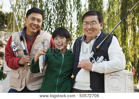 Multi-generational men fishing portrait