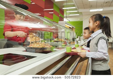 School children standing in line in school cafeteria