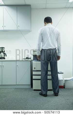 Businessman Using Photocopier