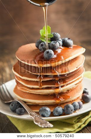 Stack Of Pancakes With Fresh Blueberry And Maple Syrup