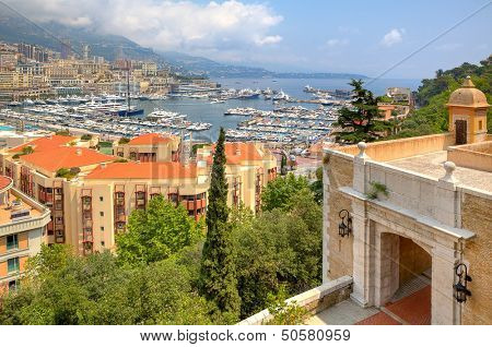 Beautiful view from ancient fortifications on port with yachts of Monte Carlo and residential buildings of Condamine quarter in principality of Monaco.