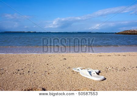 Slippers On Beach