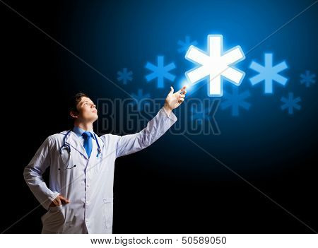 Young doctor touching with finger media medical sign