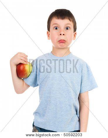boy with an apple makes a face